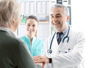 Geriatric specialist treats an elderly patient